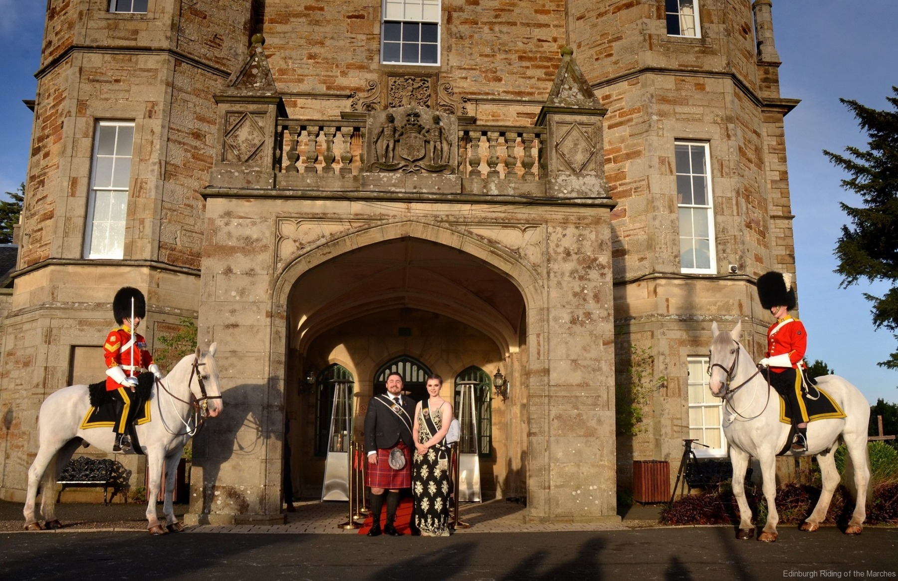 2019 Edinburgh Captain and Lass outside Dalmahoy Hotel with mounted officers of Royal Scots Dragoon Guards