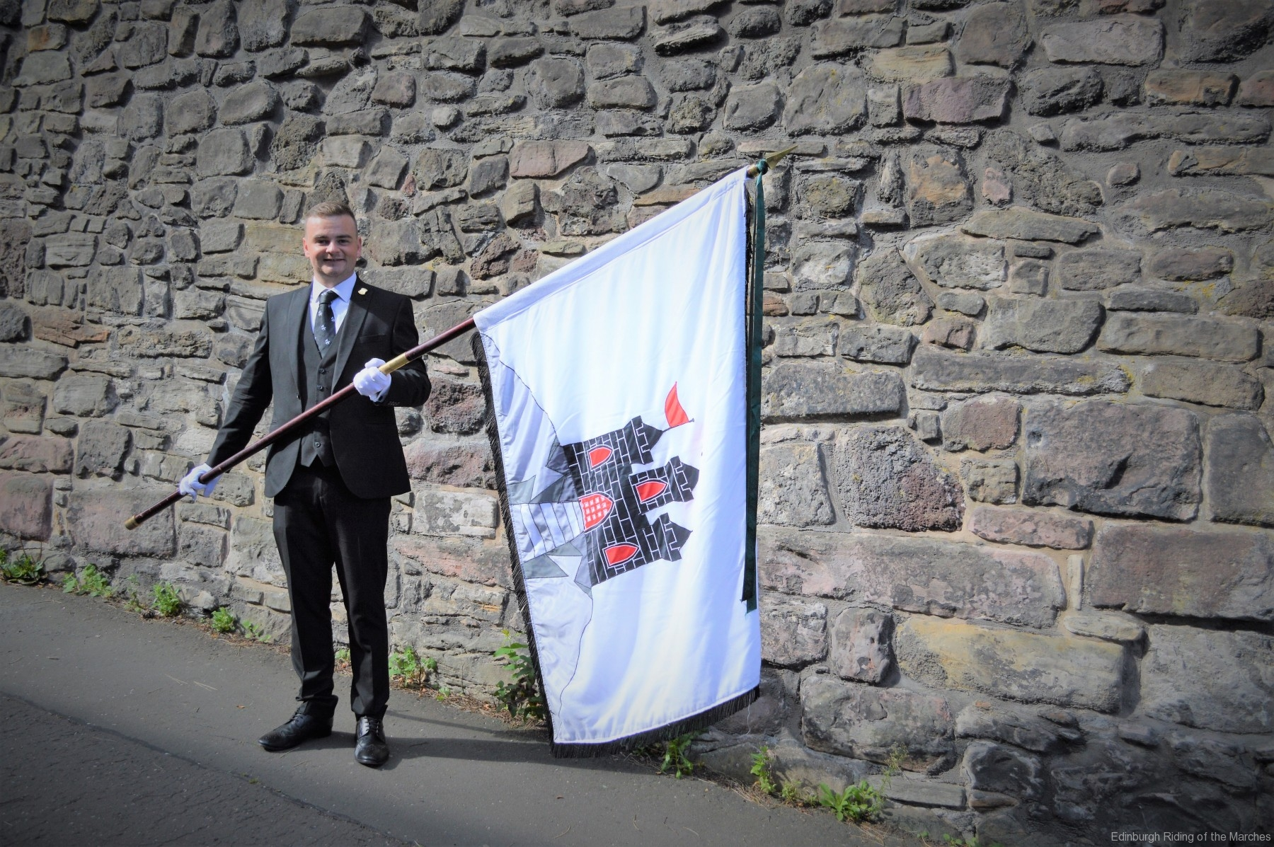 2021 Captain Elect, Jay Sturgeon carrying the City of Edinburgh Banner