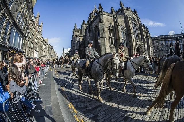 Riding past St Giles Cathedral on the Royal Mile